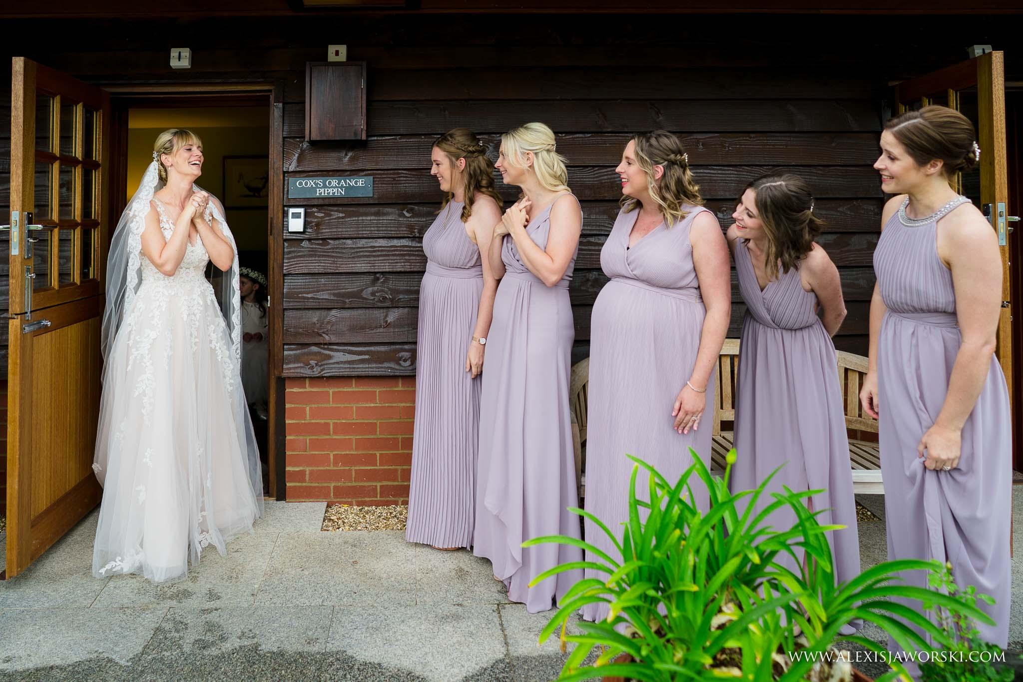 bride sees bridesmaids