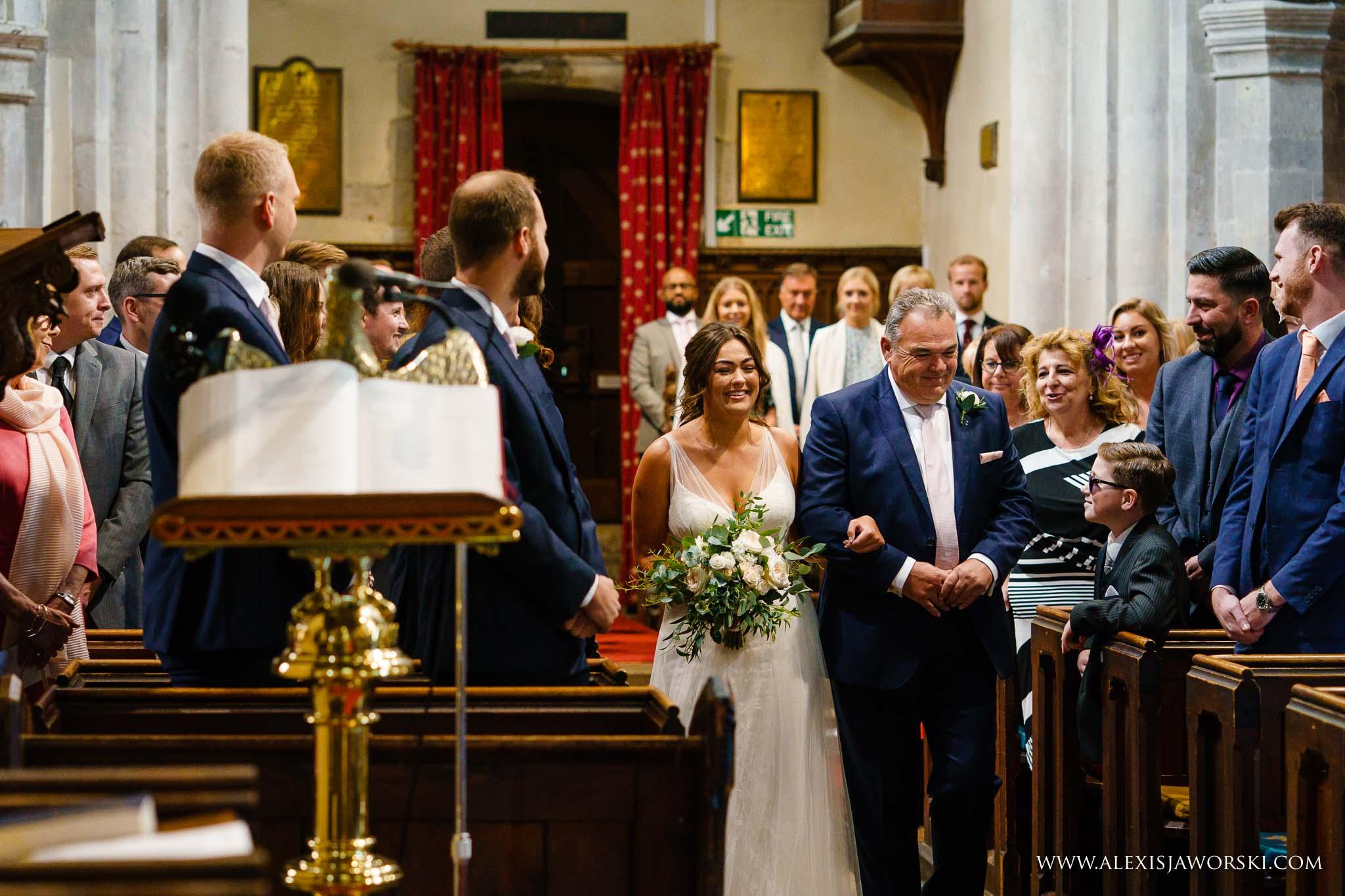 bride arriving at the altar