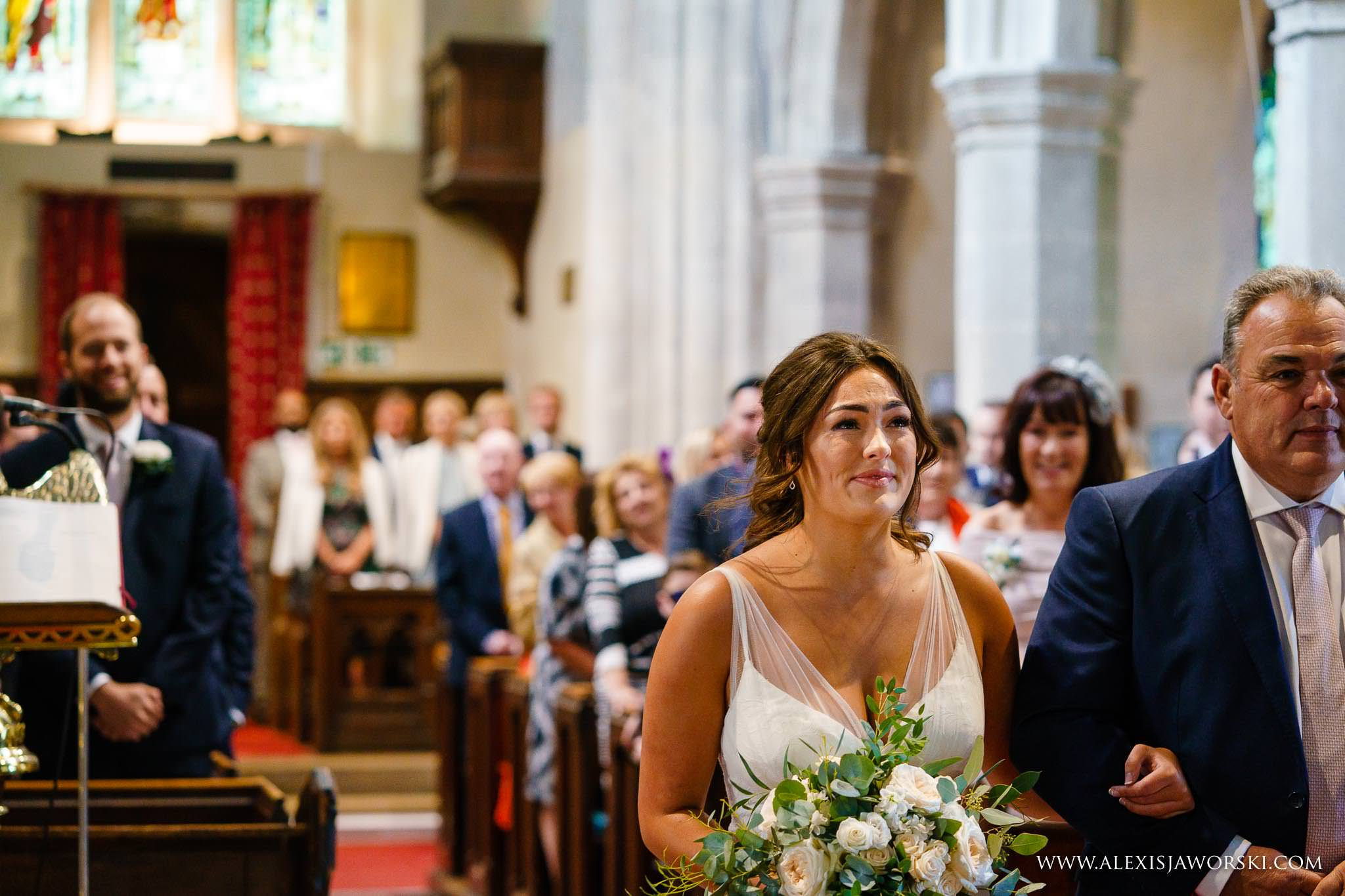 bride arriving at the altar