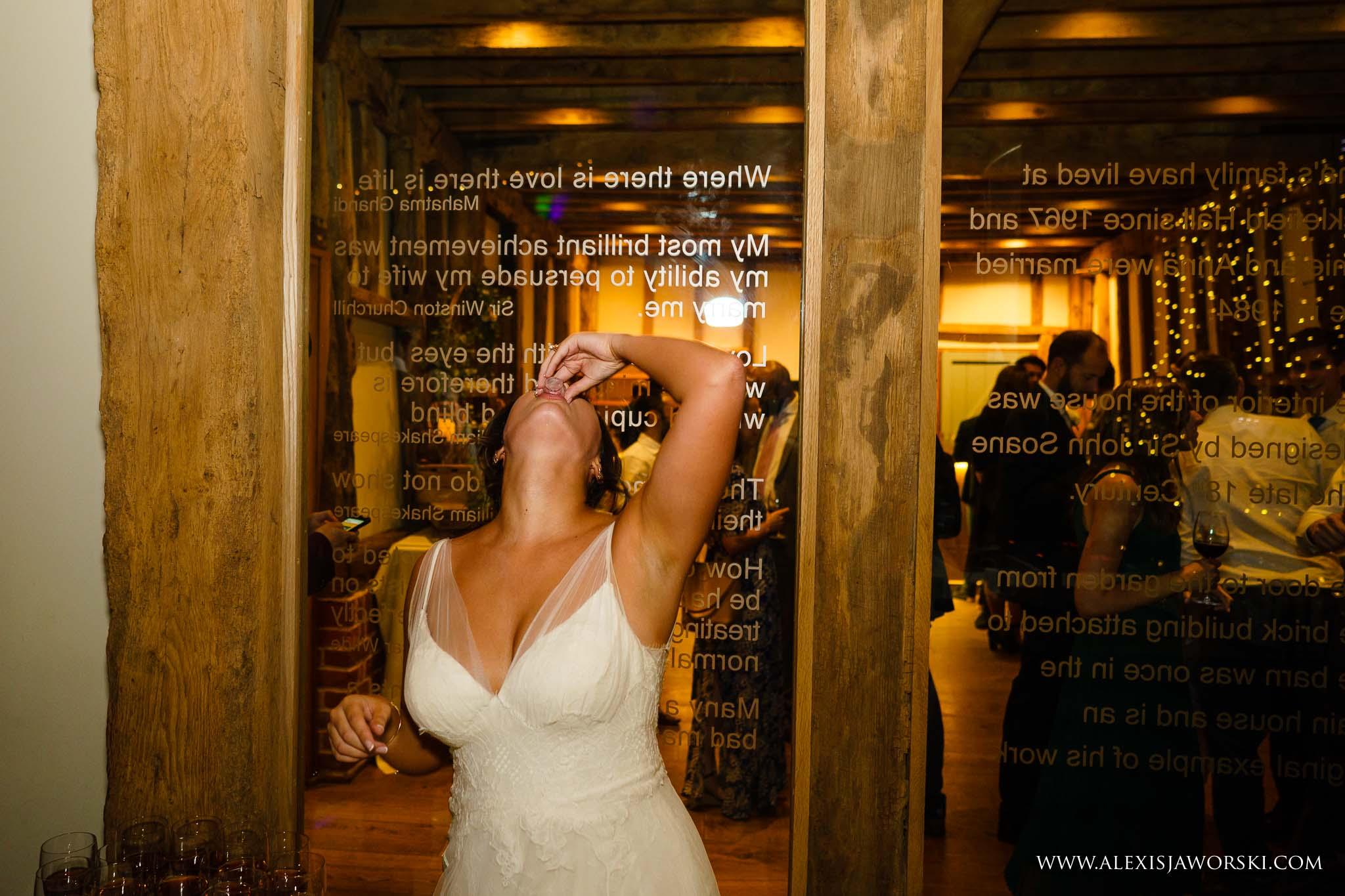 bride drinking a shot