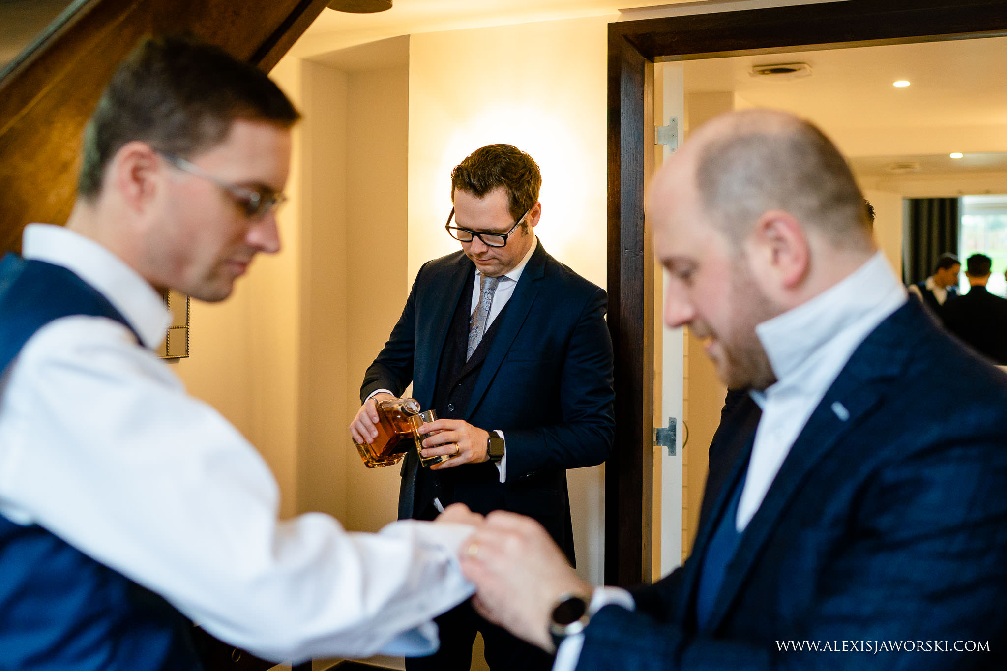 pouring whiskey for the groom