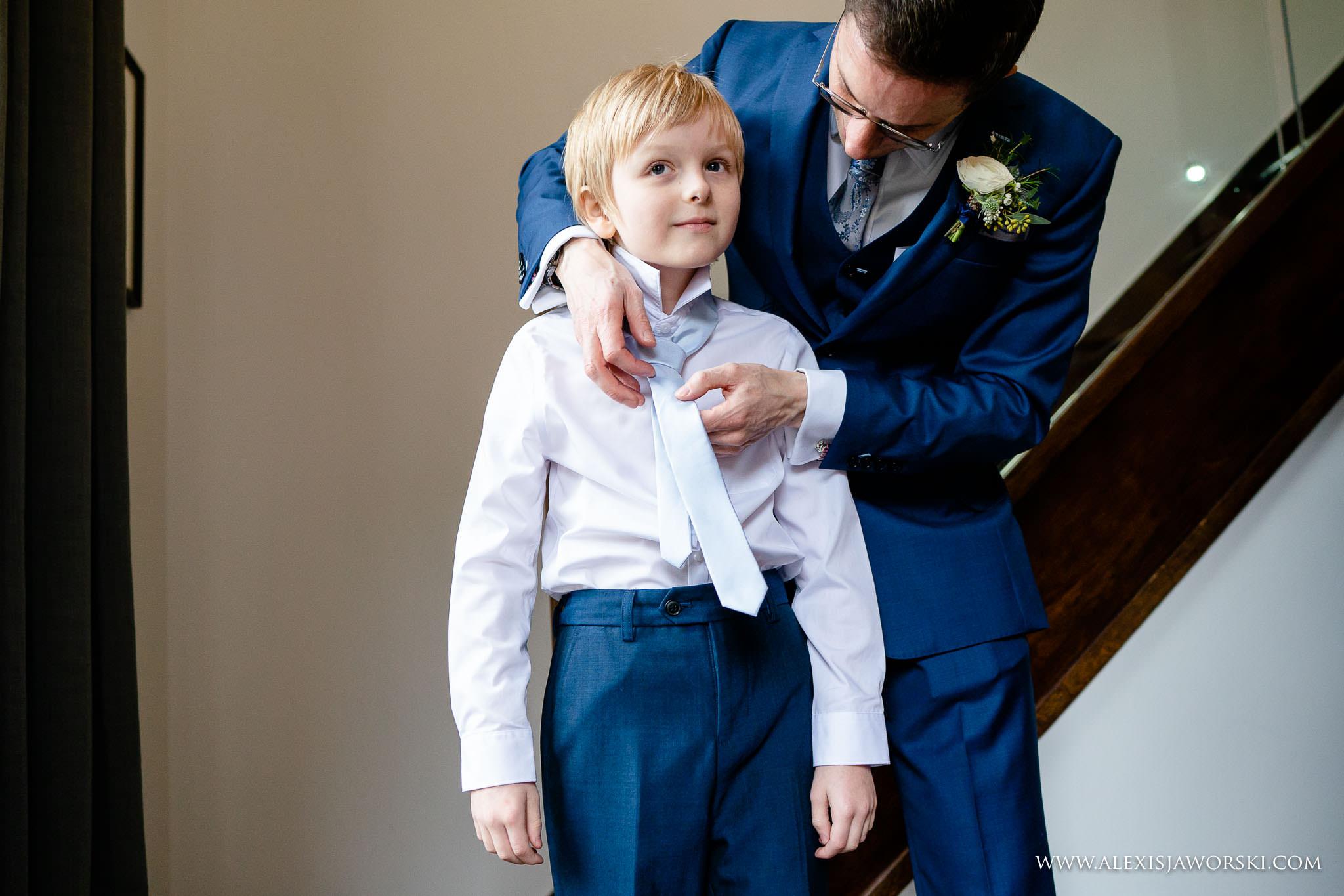 groom helping son